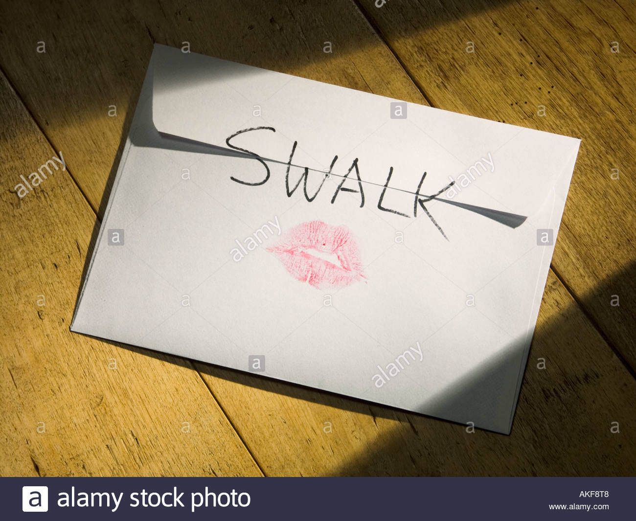 Attached picture an-envelope-with-swalk-sealed-with-a-loving-kiss-on-the-back-and-a-AKF8T8.jpg